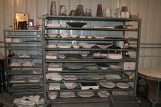 Bakers racks re-purposed for storage of fusing molds.