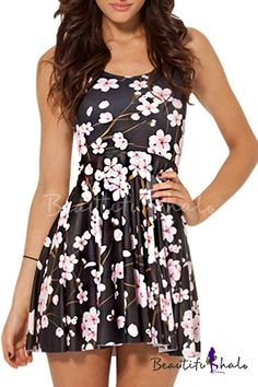 cute and flowy floral dress with beautiful pink blossoms against a black background!