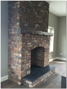 Latest Pictures Brick Fireplace insert Concepts Reclaimed brick feature fireplace with Kilkenny limestone hearth. Reclaimed Belfast bricks from Per Wood Burner Fireplace, Fireplace Hearth, Home Fireplace, Fireplace Inserts, Fireplace Design, Fireplace Ideas, Brick Hearth, Airstone Fireplace, Concrete Fireplace