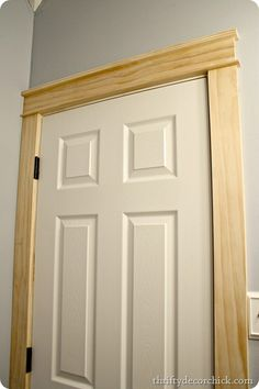DIY craftsman door trim from Thrifty Decor Chick