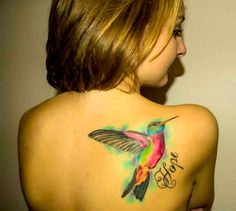 Humming Bird Tattoo on the back. For more stunning and wonderful tattoo ideas and design, visit www.tattooenigma.com