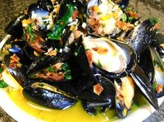 """Roy's Bacon Mussels""  ~~~ ""Steamed mussels are one of my son's favorite dishes. I love them as well. We could lterally eat tons of these babies. With the addition of bacon and fennel, these mussels make one incredible appetizer. Cooking with Passion, Sherri Logan Williams"""