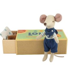 A set of lovely mouse doll and a match box filled with colorful bedding. The mouse doll features embroidered eyes, mouth and nose and a bandana. The match box is decorated with whimsical illustration