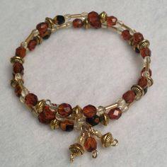 ladies beadwork bracelet tortoise brown, gold memory Wire, $24
