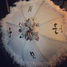 This gray and white #SecondLine umbrella is custom designed for a #NewOrleansWedding by All About Events. www.allaboutevents.net