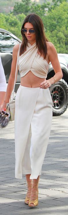 Kendall Jenner wearing culottes: Kendall celebrated Easter in a white ensemble that included structured bottoms and a belly-baring crop top.