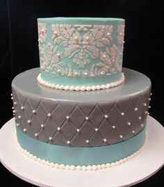I really love this gray and tiffany blue cake with white damask and pearls - very unique yet classical!
