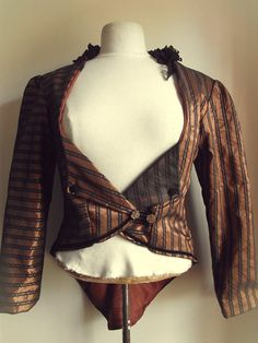 Bronze coat by NaturallyBohemian 30.00 GBPA handmade coat created from a taffeta fabric with bronze and black stripes running throughout. The black pinstri