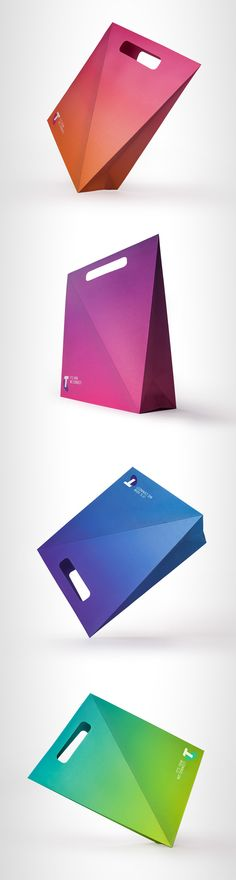 Telstra packaging | Telstra recently launched their flagship store of the future in George Street, Sydney and as part of the store experience they asked us to create an iconic carrier bag.  Our goal was to bring 'Spectrum' (Telstra's visual language of colour and angularity) to life in three dimensions.   Developed with Benja Harney and Paper-Pak.  Read more at standapart.com.au