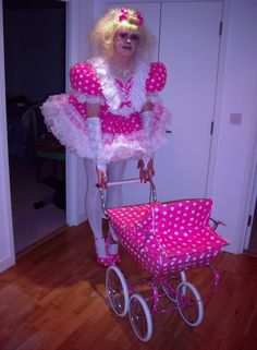 Miss Michaela with her doll in a cute matching pram