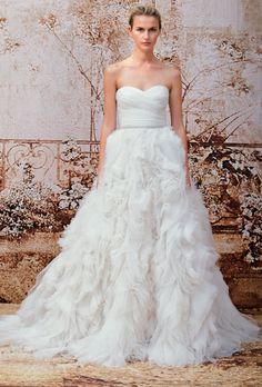 Brides.com: Monique Lhuillier - Fall 2014. Strapless ball gown wedding dress with ruched sweetheart bodice and ruffled tulle skirt, Monique Lhuillier