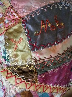 Crazy quilt with initials and flowers
