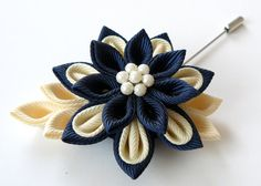 A flower is made in the technique of tsumami kanzashi. Flower is made from…