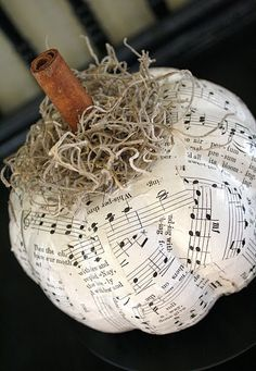 Want a quick, cheap autumn decor idea? This Dollar Store Pumpkin DIY is perfect for fall. Just get yourself one of those decently ugly plastic pumpkins for $1 and modge podge music sheets on there. Then if you would like put some moss and a cinnamon stick as the finishing touch! Let it adorn your piano or anywhere in your home.