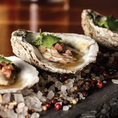 Bourbon Brown Butter Oysters with Lime Zest, Country Ham Slice, and Cilantro