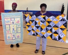 New members with their quilts