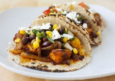 Who knew butternut squash could be so versatile? As a kid, I remember only having it around Thanksgiving and the holidays. It turns out butternut squash is great on both pizza and tacos. The squash is rubbed with ground annatto/achiote seeds, cumin, oregano, and smoked paprika. Then it's roasted in