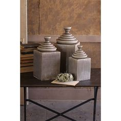 These will sit on the kitchen counter.  Grey Textured Ceramic Decorative Canisters with Pyramid Top, Set of 3