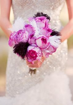 Pink bouquet with black and white feathers   Chelsea Nicole Photography