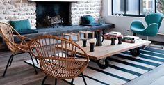 Ambiance chaleureuse et vintage, mélange de la pierre et du bois, siège Tulipe…