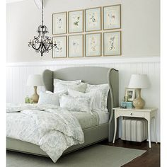 Suzanne Kasler Gourd Lamps in Camel, Wilshire Upholstered Bed with Brass Nailheads in Every Day 10oz Spa Linen, Jardin Toile Euro and Standard Shams, Quilt and Quilted Sham in Spa, Contessa Side Table, and Waldorf Chandelier from Ballard Designs
