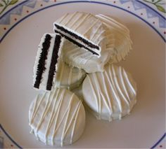 Chocolate dipped oreos- completed! made almost 400 of these for each place setting at my wedding..mine are on sticks and an aqua blue color with silver ball sprinkles.