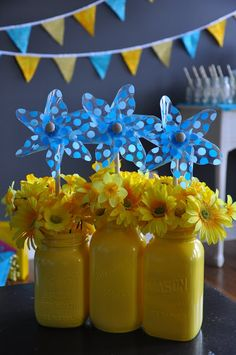 Cute flowers and pinwheel decoration! DIY spray painted mason jars. baby shower or birthday. Fig & Ruby: Rubber Ducky Party