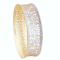The floral design engraved on the gold bangle.