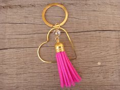 Beautiful handmade key chain with a big gold plated brass heart , beige crystal bead and fuchsia suede tassel. Our key chains can also be used as bag Crystal Beads, Crystals, Pink Acrylics, Handmade Jewellery, Key Chains, Tassel Necklace, Tassels, Jewelry Accessories, Brass