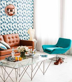 i love starting with a white canvas and using furniture and homewares to add colour. going crazy over that coffee table and the pop of teal