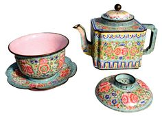 Chinese Peking enamel on copper teapot, the squared body with a squared spout and handle, polychrome decorated in the famille rose palette, on a turquoise background; paired with a covered cup, on a scalloped edge saucer with ring cutout.