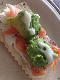 snacks to go! skyflakes cracker topped with cream cheese light, smoked salmon, avocado, tsp of mayo and add salt and pepper.