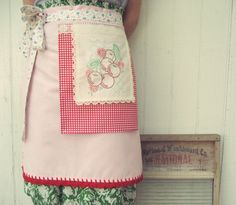 :: a sweet vintagey apron wrap with embroidered cherries, pretty floral ties, vintage lace trim, red gingham all adorned on a pretty pink fabric with pretty red crocheted scallops!   ::Handmade with lots of love by me and ready to make you feel most lovely while in the kitchen or cleaning about...