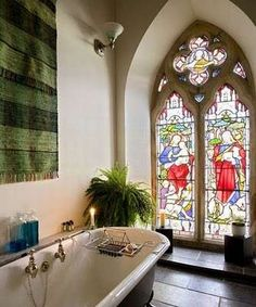 old church converted into a home - stained glass window in bathroom <3
