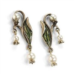 - Lily-of-the-Valley pieces are based on the undulating, botanical lines of the Art Nouveau era, a short 20 years, ending in 1915. It brought design innovations that weren't derived from any previous