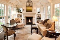 Gorgeous reading area, vaulted ceiling, limestone fireplace and loads of windows