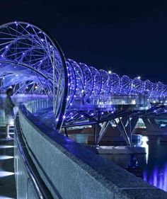 Emmy DE * The Helix Bridge is a pedestrian bridge linking Marina Centre with Marina South in the Marina Bay area in Singapore.