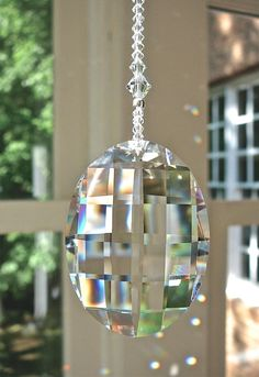 "Swarovski Matrix, Clear Oval Sun Catcher with Swarovski Crystal Beaded Strand, ""GABRIELLA,"" Lightcatcher Also Available as Fan Pull Swarovski Crystal Figurines, Swarovski Crystals, Perfumes Vintage, Accesorios Casual, Hanging Crystals, Light Pull, Sun Catcher, Mobiles, Wind Chimes"