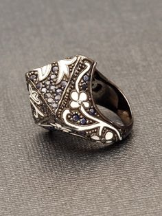 M.C.L Design Sterling Silver Black Sapphire Floral Point Ring. Sterling Silver with White Enamel and Black Sapphires. Available at London Jewelers!