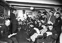 """Chief Petty Officers study books on """"Personnel Management"""", in the battleship's """"Chief's Quarters"""", circa 1923-25."""