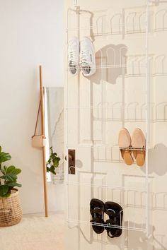 Maximize your storage space with this over-the-door shoe rack. Slim metal rack with space for 18 pairs of shoes, with 3 pairs on each tier. Looped wire bars are shaped to hold shoes without damaging…
