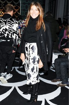 Nina Garcia in an animal print skirt and cozy turtleneck