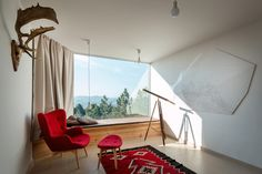 For this hillside home built in Serbia, the architects at EXE Studio used a natural color palette and locally-sourced materials to blend the house's angular form into the rolling hills of Mount Maljen.