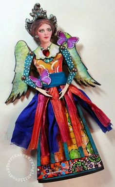 By Terri Kahrs using the Small Santos Cage Doll Kit and Angel Wing Cut Outs from Retro Café Art Gallery. www.RetroCafeArt.com