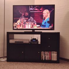 Alright, so after using a microwave cart for months, the hunt was on for a quality TV stand. There were none at IKEA that fit the theme of my family room. So