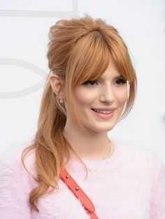 I love these long bangs parted in the middle and also this strawberry blonde color gorgeous on fair skin:)