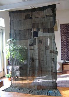 Nine Panel Boro Hemp Kaya... boro, nine panel, loosely woven, hemp kaya is overdyed: it was first dipped in indigo, then dipped again in a yellow dye. Like the post below this one, this kaya is from the Tohoku region, or rural northeast of Japan.