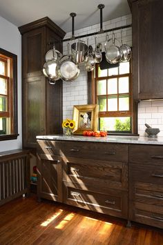 The charm of the farmhouse kitchen cabinet does not just happen when Fixer Upper debuted. They've been there for a long time - check out these beautiful Home Kitchen Ideas, farmhouse kitchen cabinets, farmhouse-style kitchens to get your kitchen inspired. Dark Brown Kitchen Cabinets, Brown Kitchens, Farmhouse Kitchen Cabinets, Kitchen Redo, Home Kitchens, Kitchen Ideas, White Cabinets, Kitchen Counters, Shaker Cabinets
