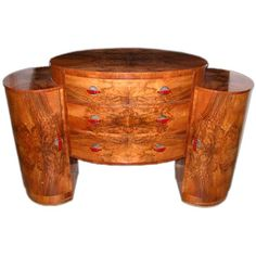 Chic and Richly-Paintated French Art Deco Oval-Form, Three Drawer Sideboard   From a unique collection of antique and modern sideboards at https://www.1stdibs.com/furniture/storage-case-pieces/sideboards/