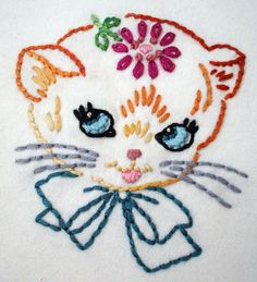 Adorbs.  My aunt used to embroider pillowcases a lot like this for my sister and I.  I still have a few of them, but they're so delicate now I don't use them anymore. >>> Kitty embroidery.